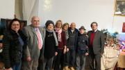 I componenti del Movimento per la Vita di  Palermo posano davanti ai 99 presepi. La mostra è visitabile fino al 6 Gennaio. Sulla destra,l 'organizzatore Vito Brunetto.