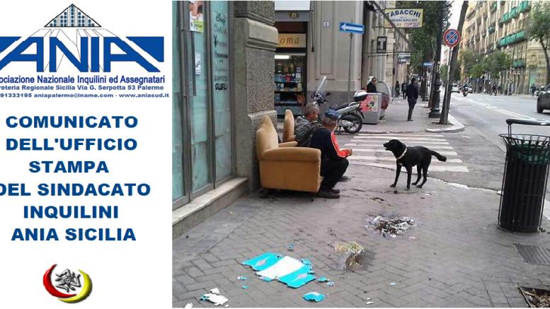 """L'ANIA si premura di inviarci anche la sua immagine esclusiva del degrado di via Roma. I resti di quella che fu una grande e attiva arteria cittadina, ospita cani e barboni, che fruiscono di vecchi mobili abbandonati - I marciapiedi sono una discarica, i negozi hanno abbassato """"sine die"""" le saracinesche. Il resto di Palermo, dentro e fuori la Città murata, è """"in armonia"""" con tale realtà."""