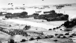 """Un'immagine dello sbarco in Normandia. Ecco i potenti mezzi messi in campo dagli """"alleati"""". Similare fu il modo in ci si presentarono sulle coste italiane e  siciliane. Insieme ai numerosi stati Usa e all'Inghilterra, era schierato l'intero Commonwealth. Messina e Augusta furono sottoposte a bombardamento orizzontale da navi in buona parte canadesi. Le truppe americane avevano varcato l'oceano contro l'Europa già nella prima guerra mondiale. In Sicilia furono mandati aventi i marocchini con licenza di saccheggio di stupro. I caccia americani mitragliarono la popolazione civile """"ad effetto morale""""."""